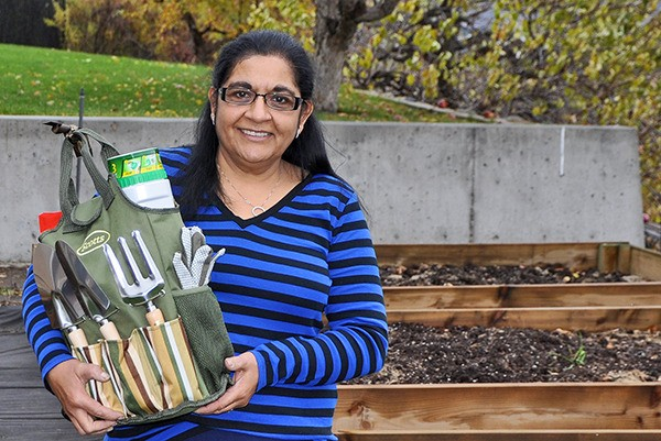 Shila Natha with her prize from Scott's Miracle Grow
