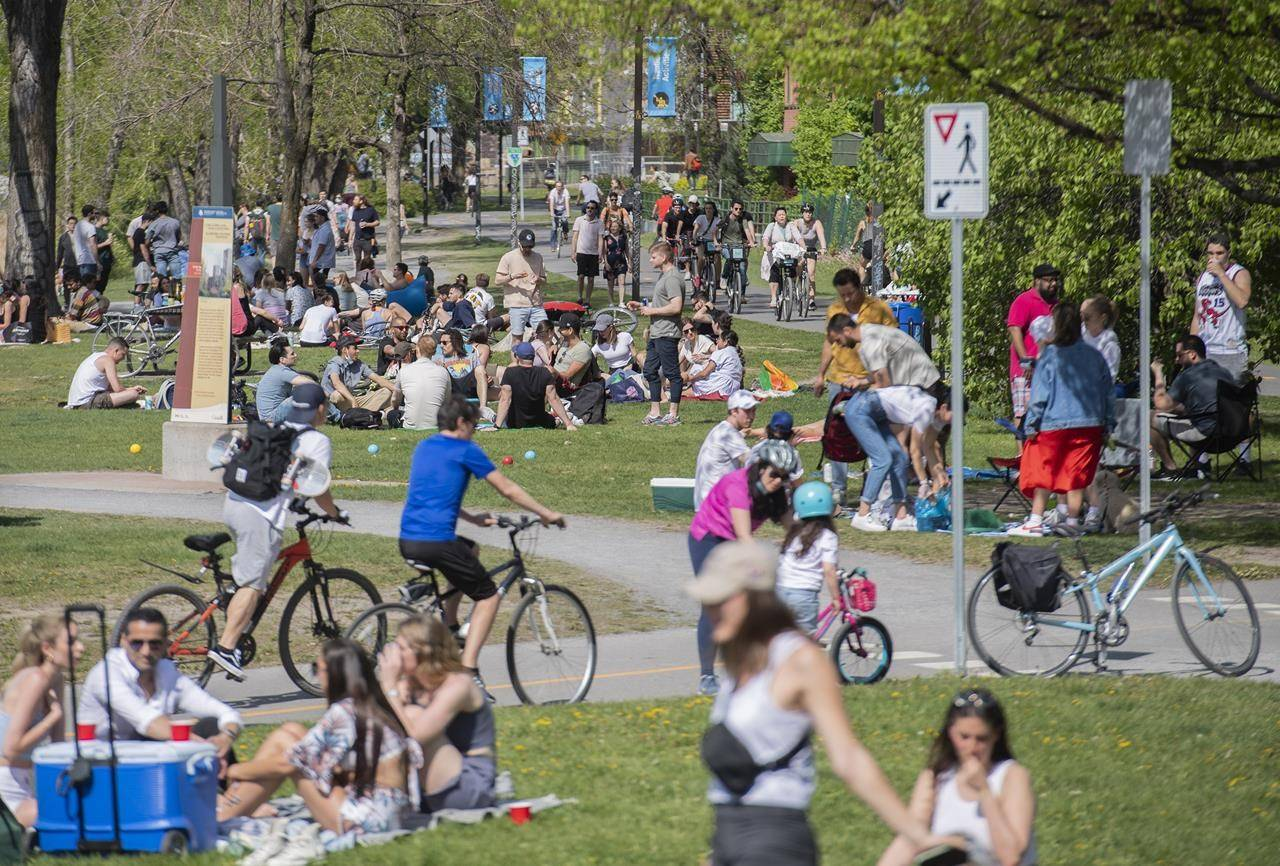 People gather next to the Lachine Canal on a warm spring day in Montreal, Saturday, May 15, 2021, as the COVID-19 pandemic continues in Canada and around the world. A machine learning model used health data collected routinely to predict the majority of people most likely to develop the disease, says the lead author of a study that suggests the findings could be used to create targeted prevention programs years before someone develops the disease. THE CANADIAN PRESS/Graham Hughes
